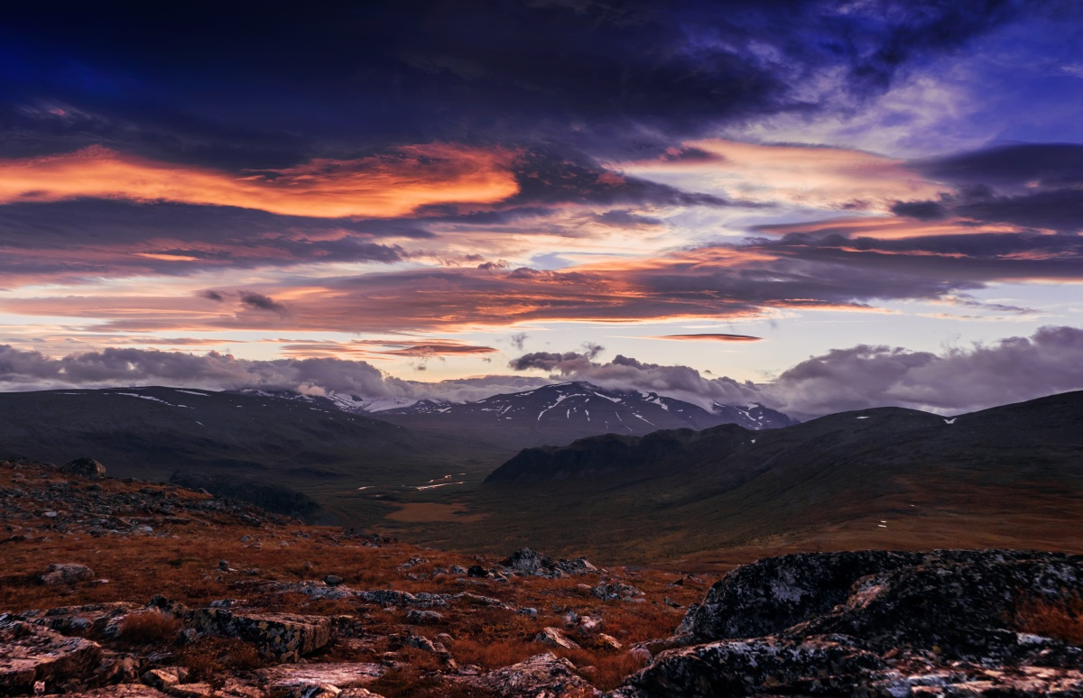 Photo of sunset over river valley in Sarek National Park.