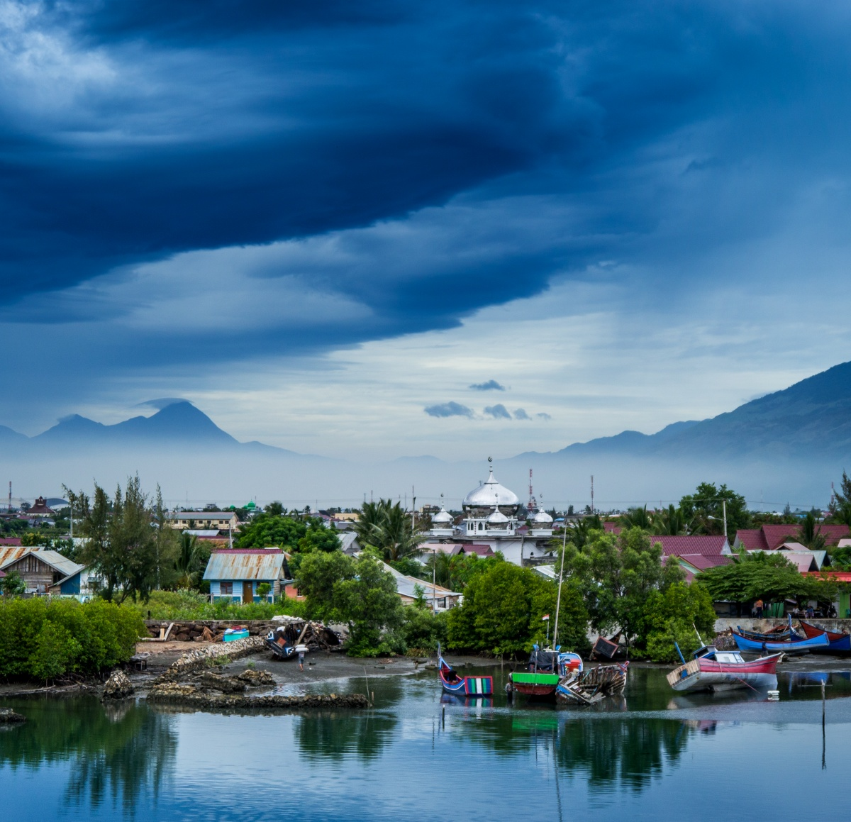 Photo of early morning in Banda Aceh. Big clouds and misty mountains.