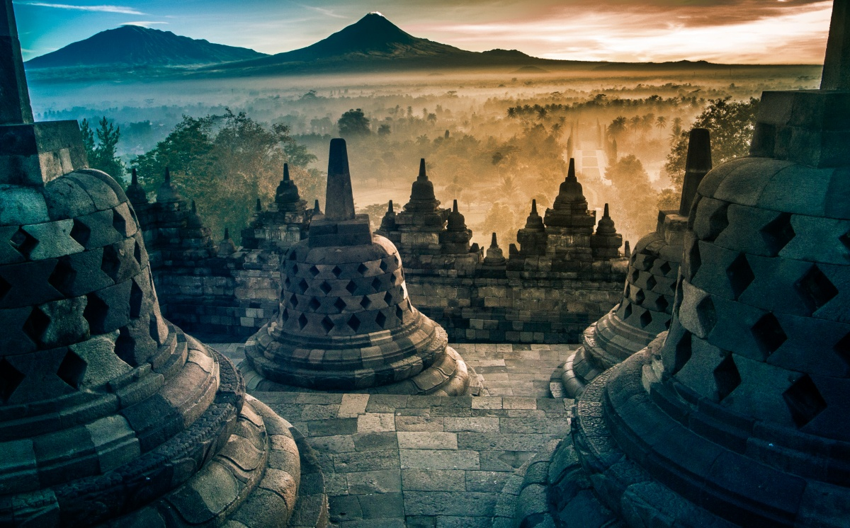 Amazing view from top of Borobudur to misty valley and volcanos on sunrise