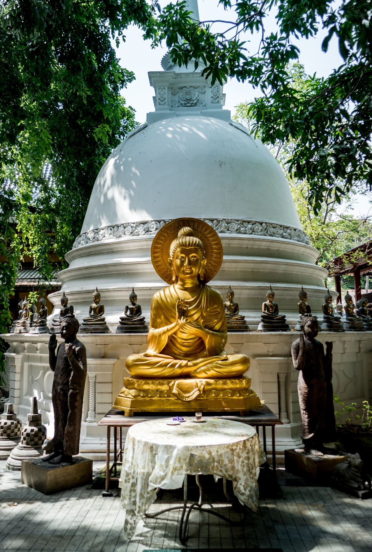 Buddha statue in Gangaramaya temple, Colombo Sri Lanka