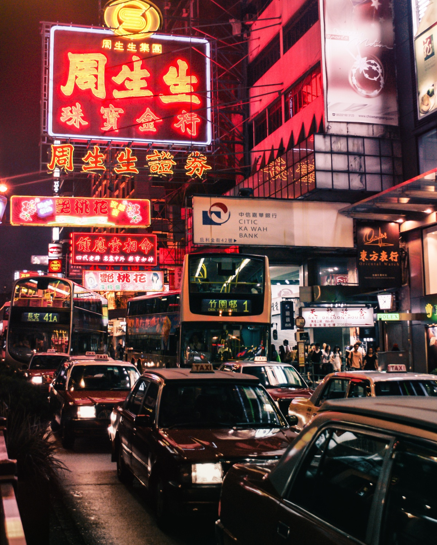 Photo of neon light and traffic rush in Hong Kong, Nathan Road, Kowloon.