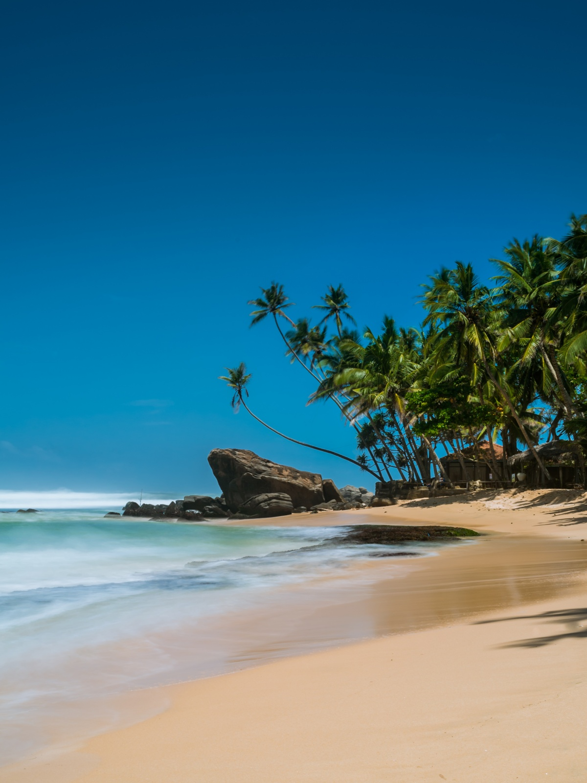 Long exposure photo of beautiful beach paradise in Mihiripenna, Sri Lanka.
