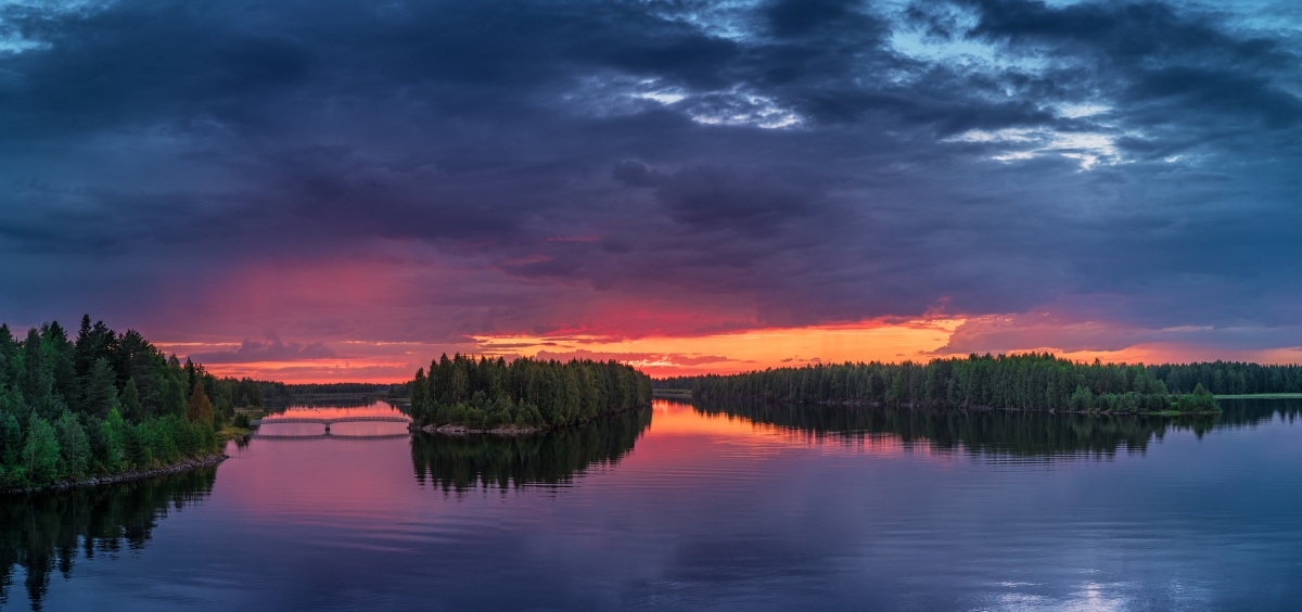 Panorama photo of sunset over river Oulujoki, Vaala, Finland