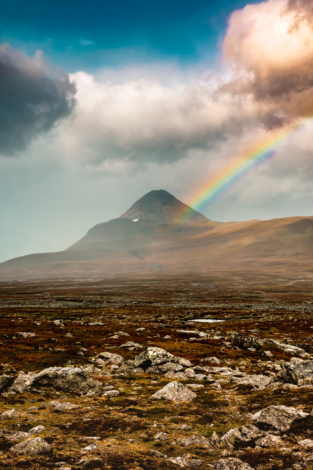 Photo of colorful rainbow over Barras Mountain in Northern Sweden