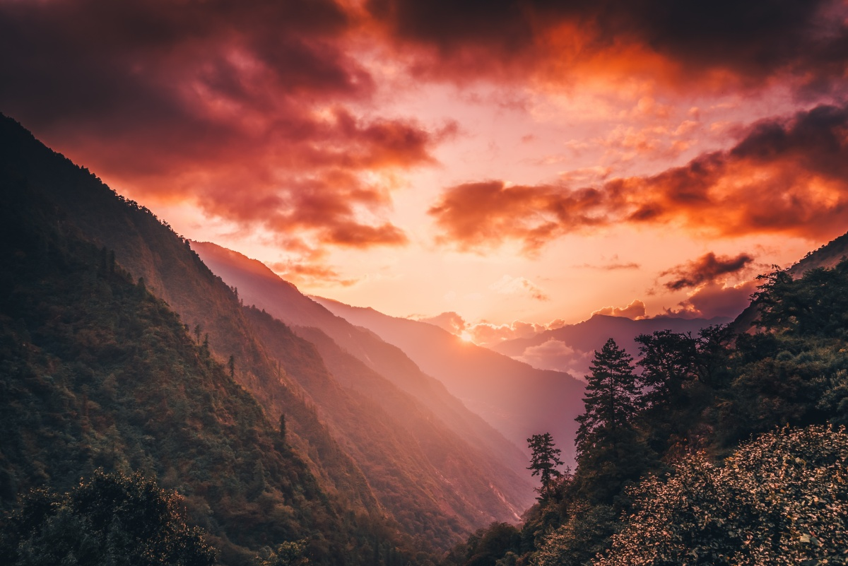 Photo of beautiful red sunset in Himalayan river valley