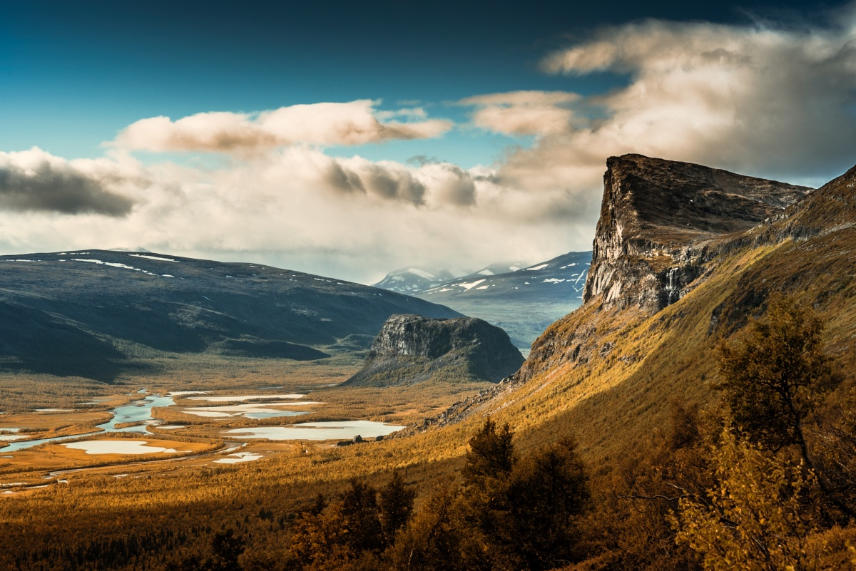 Autumn colors and beautiful landscape over Sarek river valley and Skierfe cliff