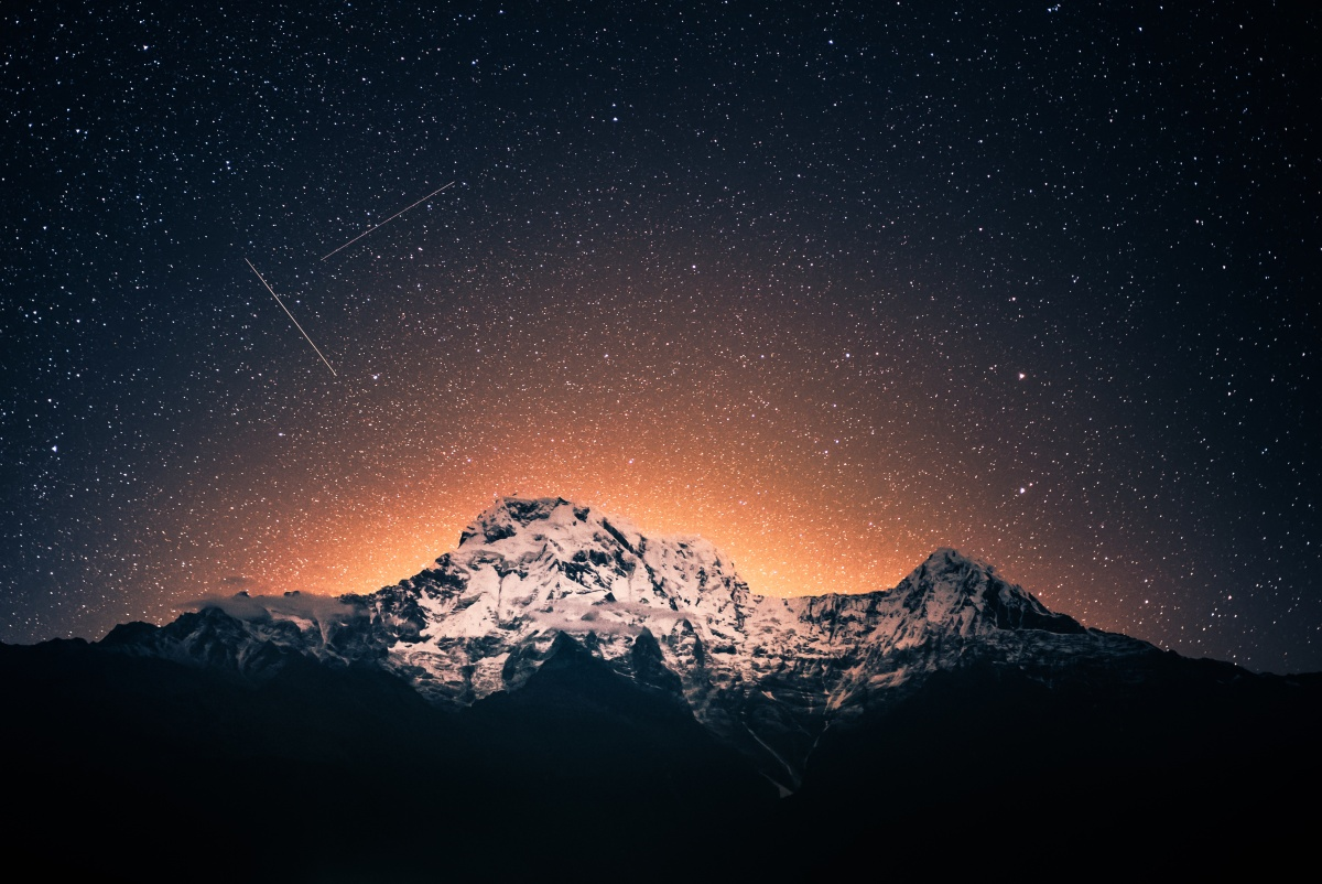 Photo of a starry sky over Annapurna mountain range near Pokhara in Nepal