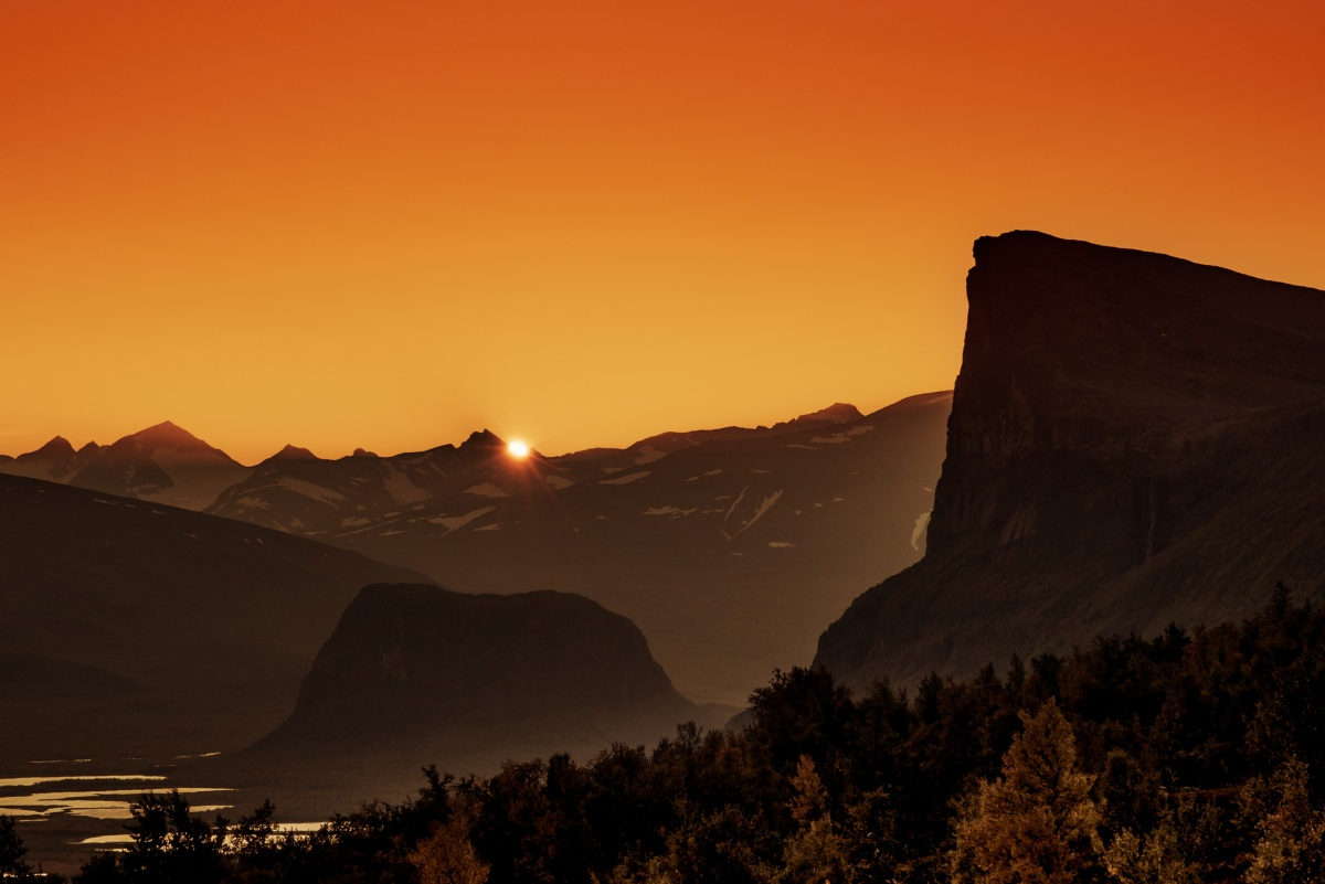 Photo of amazing sunset over river valley and Skierfe cliff