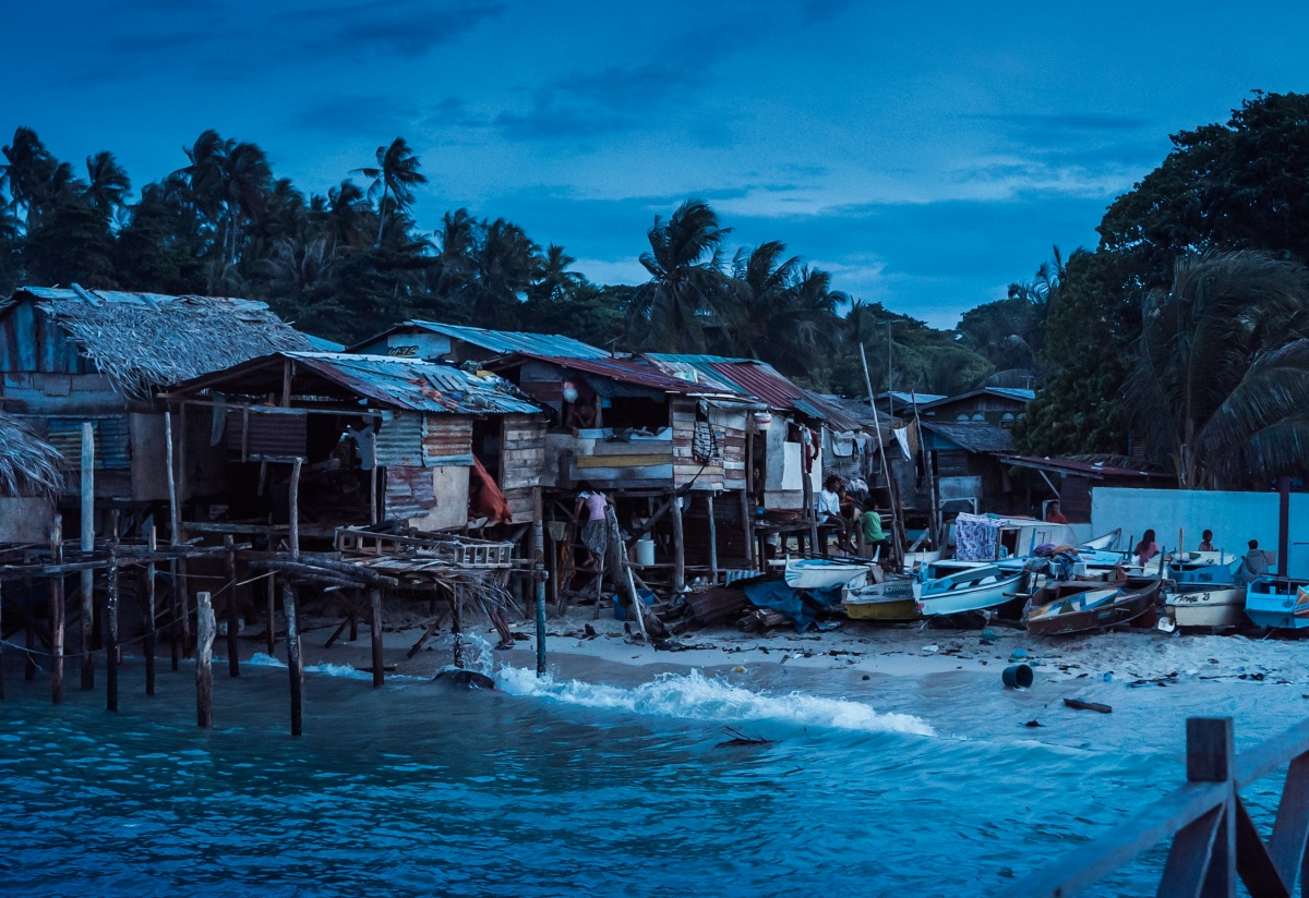 Photo of poor looking fishing village on tropical Mabul island. The photo was taken at night.