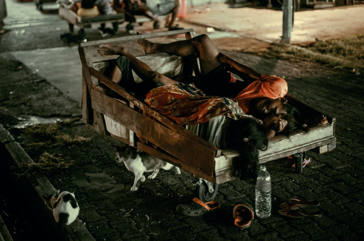Photo of two women sleeping in cart